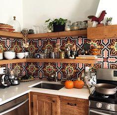 Tiles below the shelves