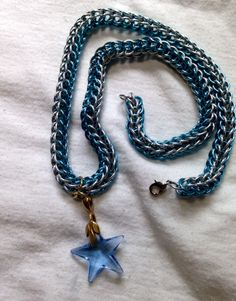 Chainmail necklace in blue&silver 18 gauge 1/4 inch rings with a blue Swarovski crystal star.