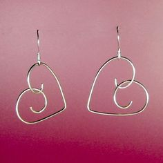 Hand-formed .925 sterling silver hearts of 20 gauge wire suspended from .925 sterling silver ear wires.