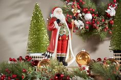 Santa stands tall and is accented with harlequin check. Christmas Wreaths, Christmas Decorations, Christmas Ornaments, Holiday Decor, Luminara Candles, Valerie Parr Hill, Home Candles, Stand Tall, Santa