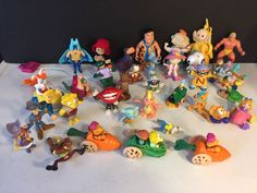 mixed lot of 33 early 90's cartoon toys dinosaurs rugrats fraggle hulk from $8.99