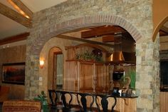 Stone and brick archways are a wonderful way to combine rustic and modern influences. (Home Design & Decor by B.L. Rieke & Associates, Inc.) Visit us at blrieke.com