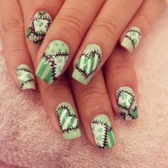 patchwork hearts nail art design in green