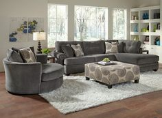 Set the Mood. The smooth graphite shade and velvety soft texture of the Catalina II Gray sectional collection creates an intimate, cozy atmosphere that will have you dimming the lights and putting on some music. A perfect starting point for a more dramatic look, the set also includes a pop of frenzied pattern and overstuffed cushions made for curling up with a good book — or that special someone.