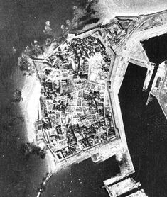AUG 17 1944 A shattered city – 'Festung St Malo' – surrenders A post war aerial shot of the old port of St Malo -where most of the old granite buildings had been destroyed. St Malo, A Little Party, White Flag, Old Port, School Subjects, American Soldiers, D Day, World War Two, Saint