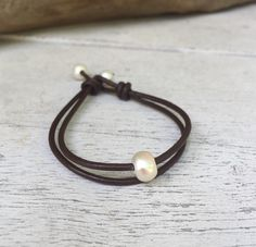 A personal favorite from my Etsy shop https://www.etsy.com/listing/236768673/leather-freshwater-pearl-bracelet