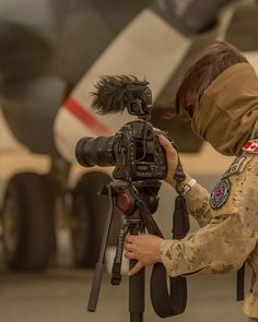 A Combat Camera imagery technician films a CP-140 Aurora during a sandstorm during Operation IMPACT in Kuwait on February 8, 2015. Photo by: Canadian Forces Combat Camera, DND