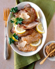 Pan-fried pork cutlets are lightly flavored with citrus and Parmesan.