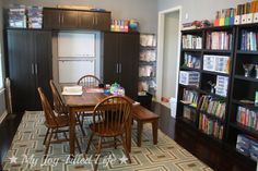 Our Homeschool Room Reveal {finally} - My Joy-Filled Life...love this formal dining turned homeschool room, cabinet/shelving is amazing!