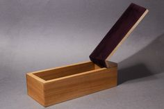 Fold box by Laurence Brand, made of English cherry and rippled sycamore, lined with purple pig suede