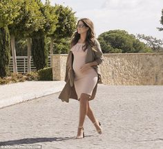 Model moment: Binky Felstead didn't let her burgeoning baby bump slow her down as she cont...