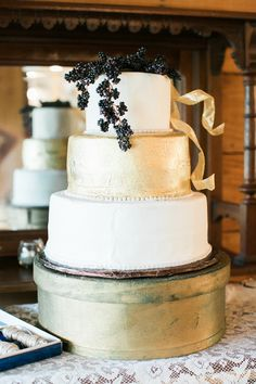 Gold Wedding Cake With Blue Berry Accents