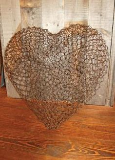 For 15+ years I have found heart shapes to be cheesy & overused. But I have to say, I'm beginning to understand & respect the iconic value.  So when I see this - texture - imagine the shadows it would cast & how they would change w/ the changing light.   I change my mind!