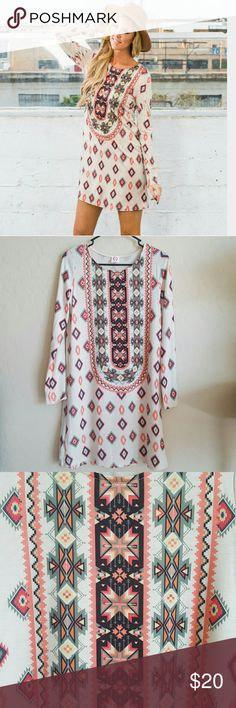 🎀New Listing! Tribal print tunic dress NWOT Gorgeous cream dress with Aztec print in sage, coral, pink, black, yellow, and taupe. Lightweight and soft with crew neck and long sleeves. I ♡ it but it just doesn't look good on me 🙁. Never worn (didn't come with tags). Wanna B Dresses