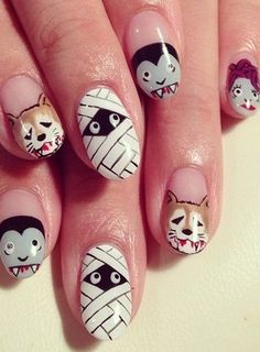 Photo La manucure monstre vue sur Pinterest - Les 100 nail art terrifiants d'Halloween - Beauté - Be.com