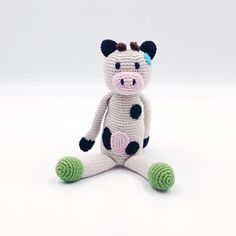 A handmade soft filled cow with built in rattle and bold colours to keep your baby captivated. A thick crochet finish makes it easy to hold and comfortable against delicate skin. Long slender limbs for the natural grasp reflex of babies. Approx 25cm long. Material & Care - 100% cotton. Warm wash on 40° or lower. Crochet Cow, Crochet Baby Toys, Cotton Crochet, Baby Girl Gift Sets, New Baby Girls, Cow Toys, Muslin Baby Blankets, Cute Cows, Baby Arrival