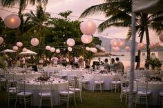 Thailand beach front outdoor wedding reception under fairy lights and lanterns