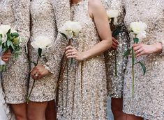 Sparkly bridesmaids with a single flower as bouquets that could match the wedding bouquet of the gorgeous bride! Sparkly Bridesmaid Dress, Gold Bridesmaids, Wedding Dresses, Sparkly Dresses, Bridesmaid Gowns, Beaded Dresses, Bridesmaid Bouquet, Wedding Attire, Wedding Trends