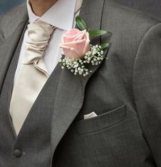 Pink rose buttonhole with gyp