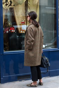 Great classic oval coat. Notice the earrings, glasses, and shoes to bring artistry that says who she is.