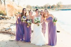 I love that this couple did not go the traditional autumn wedding way, but instead, showcased the beauty of the fall colors with a complimentary lavender. Capital LOVE. They dressed up the already fab Chesapeake Bay Beach Club in a