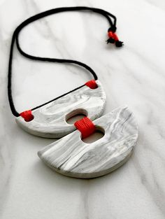Double grey and white marbled statement necklace 100% Handmade Marbled and molded using polymer clay Black rope cord Red/orange detail thread nonadjustable