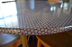 Cover an old table with oilcloth (staple gun)