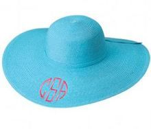 Aqua floppy sun hat with hot pink monogram in circle font. Monogram is embroidered on the front of the hat.