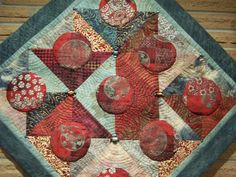 Designed and quilted by Colleen McKeeman.  It hangs over my family room fireplace.  I died some the fabric used in this quilt.