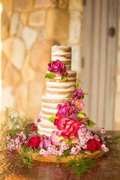 Naked wedding cake decorated with florals