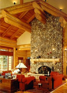 Soak up the warmth from this stunning living room. #loghome