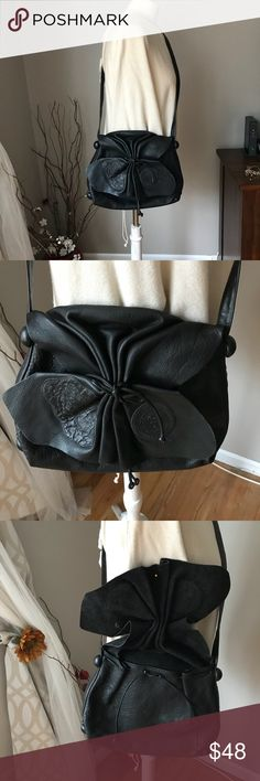 """Carlos Falchi black vintage bag Unique vintage designer leather bag is  embossed Carlos Falchi. Patches on the front . The bag is leather with a gathered butterfly front flap, drawstrings on the main compartment and one small zipper pouch inside. About 13""""x11"""", straps 56"""". The brand is very expensive. Perfect condition Bags Shoulder Bags"""