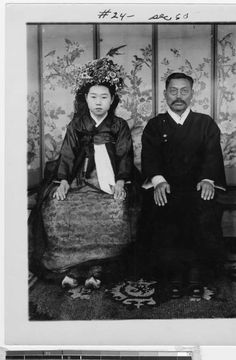 Bride and groom seated in front of a painted screen, Korea, ca. 1920-1940. http://digitallibrary.usc.edu/cdm/ref/collection/p15799coll123/id/10237