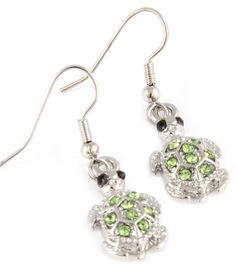 """Adorable Small Shimmering Green Crystal Turtle Charm Dangle Silver Tone Earrings for Girls Teens Women. Dainty turtles are embellished with sparkling green crystals. Jewelry by Glamour Girl Gifts is coated with imitation rhodium to help prevent tarnishing and discolorations. Lead and nickel safe. French hook backs. Earring charms measure about 1/2"""" wide x 3/4"""" tall with a a 1-1/4"""" drop. Comes packaged ready for gift-giving. All products will arrive to you in either a gift box,..."""