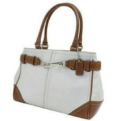 AUTHENTIC COACH F11199  CREAM  COLOR CARRYALL ** LIKE NEW ** AUTHENTIC  COACH  F11199  CREAM COLOR CARRYALL CLASSIC & AND EXCEPTIONALLY CLEAN!  SOFT CREAM LEATHER WITH LIGHT BROWN BELT AROUND TOP SIDES SNAP SILVER ACCENT IN FRONT (no scratches) 4 SILVER METAL FEET ON BOTTOM ZIPPER COMPARTNT WITH 2 POUCHES INSIDE MEASUREMENTS 12 X  8 X 3.5 I've never used it but it still has a thin mark on inside near Zipper, tiny , barely noticeable spot on front & a fade mark on bottom from storing it…