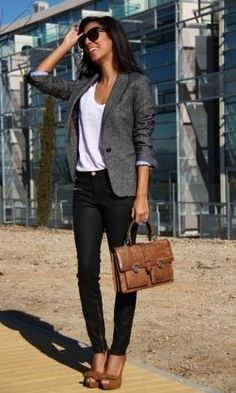 Gray blazer w/ black skinnies with brown leather accessories.  Classy www.ensembleapparel.com