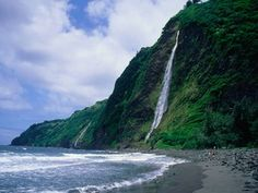 Of all the beaches on the Big Island, the unspoiled crescent of black sand at the base of Waipio Valley is easily the most secluded: it's sheltered by 2,000-foot cliffs and it's a grueling three-mile hike down. But don't be dissuaded: you'll be rewarded handsomely for your efforts with superfine, inky sand and calm, clear turquoise water. Look to the east, and you'll spot the spectacular Kaluahine Waterfall (pictured) and the larger Waiulili Falls, which can be accessed by a rocky trail…