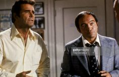American actors James Garner (L) and Joe Santos in a still from an episode of the television series, 'The Rockford Files,' circa 1974.