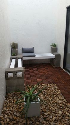 Our cynder block bench. Added IKEA patio flooring and a couple of succulents for ambiance.