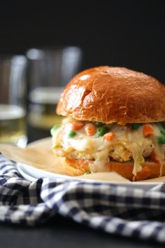 Chicken Pot Pie Burger - the patty is made of chicken and topped with all things pot pie – carrots, onions, celery, peas, all sandwiched between a bun.