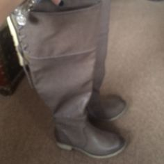 Above knee grey boots Brand new, Really cool above knee boots, tie in top back, side half zip, just bought on this sight, I'm a 61/2, an these are a 6, but take 6 in most boots, asked if they roomy enough for 61/2 ...... Well they're not.... Definitely a 6, to tight for me, but super cool boots!! Charging less then I paid, paid $65.. Mia Tamara Shoes
