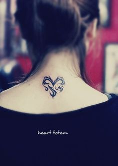 a #heart #tattoo on the back consist with totem type of lines by loracia