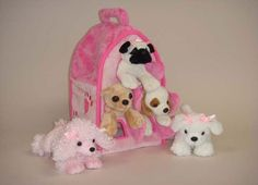 Plush Pink Dog House with Dogs - Five (5) Stuffed Animal Dogs in Pink Play Dog House Case, http://www.amazon.com/dp/B003C5UR9E/ref=cm_sw_r_pi_awdm_UUzlwb0FEEV5D