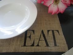 """Burlap Stenciled Placemats- instead of """"EAT"""" do the guest's name so they know where to sit?"""