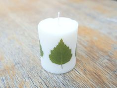 Soy wax candle is decorated natural Birch leaves. Every candle is unique and different because it is handmade. Birches leaves give candle a touch of