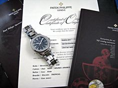 A SUPER NICE PATEK PHILIPPE 5065 STAINLESS STEEL AQUANAUT. IN EXCELLENT CONDITION. COMES WITH LEATHER BOOKLET, PAPERS AND CERTIFICATE. CASE MEASURES 39 x 45 MM. ORIGINAL GORGEOUS BLACK TEXTURED DIAL, HANDS AND CROWN. BRACELET MEASURES 7 1/4 INCHES APPROXIMATE. 29 JEWELS PATEK CAL.315 SC AUTOMATIC MOVEMENT. High End Watches, Patek Philippe, Booklet, Michael Kors Watch, Certificate, Dating, Stainless Steel, Hands, Crown