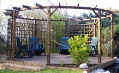 Circular pergola with curved trellis over octagonal patio- ropes would look great with thornless roses trained over them.