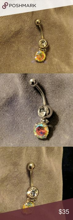 Mystic Topaz Sterling Silver Bellybutton Ring Mystic Topaz Sterling Silver Bellybutton Ring w/ CZ. This Topaz catches ever color of the rainbow...Super Sparkley NIB Jewelry