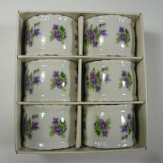 Porcelain napkin rings in a violets pattern....wish I had these! Darn, beautiful forsure.