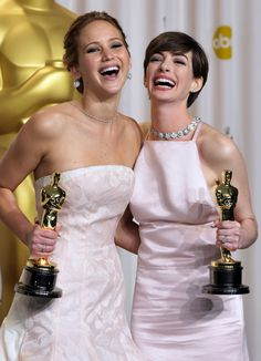 Jennifer Lawrence and Anne Hathaway pose with their awards during the Oscars at the Dolby Theatre on Sunday Feb. 24, 2013, in Los Angeles.